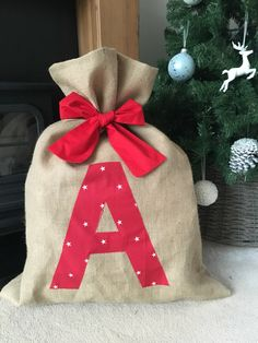 A personal favourite from my Etsy shop https://www.etsy.com/uk/listing/261376278/initial-hessian-christmas-sack