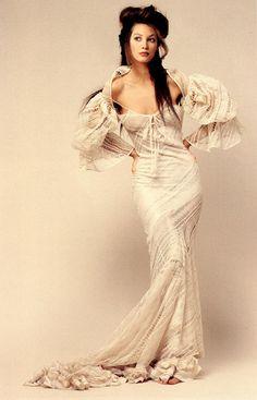 White Harper's Bazaar, January 1993 Photographer: Patrick Demarchelier Model: Christy Turlington Cotton lace dress by John Galliano
