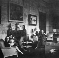 Vicomtesse de Noailles in her salon with novelist Philip Toynbee and cellist Maurice Gendron. Photograph by Cecil Beaton, 1938.