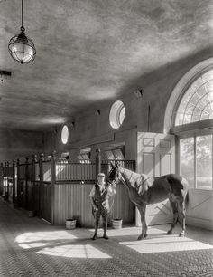 """October 12, 1933. Huntington, Long Island. """"Marshall Field estate at Lloyd Neck. Interior view of polo stables."""" Photo by Samuel H. Gottscho."""