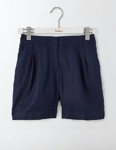 #Boden Lottie Linen Shorts Navy Women Boden, Navy #Two things you need when the sun comes out: ice cream AND these lightweight linen shorts. Pick from three lengths (all with turn-up hems), so you can decide how much leg you want to show off. The elasticated-back waistband keeps them comfortable whether youre paddling or promenading.
