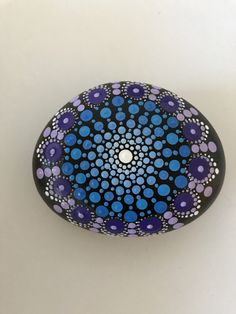A personal favorite from my Etsy shop https://www.etsy.com/listing/510001829/mandala-stone-hand-painted-rock-dot