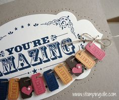 Tiny tickets create a fun banner across the You're Amazing Card