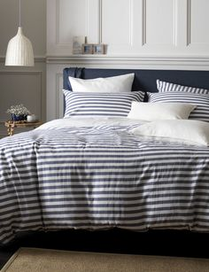 Coastal bedroom interiors. Our favourite set of striped bed linen for a nautical bedroom style. Navy and white striped bed linen paired with white walls and coastal accessories will have you wishing you were waking up next to the seaside.