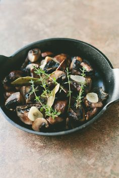 Marinated Mushrooms Ingredients  2 pounds cremini or button mushrooms, cleaned and quartered 2 lemons, zested and juiced 3 garlic cloves, sliced 1 small bunch fresh thyme 2 teaspoons chopped fresh rosemary 2 bay leaves Kosher salt and freshly ground black pepper