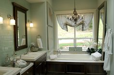 I officially need a chandelier over my bath tub!