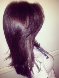 Long layered hair cut.. I wouldn't have those shorter bangs though...just the longer ones that end at my chin (like how I have it now). I just have to wait for my hair to grow to my waist and then I'll thin out the middle/top of the bottom section of my hair.