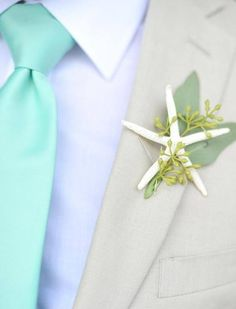 Groomsmen and groom seashell