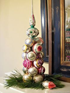 Christmas in a Minute: Ornament Tree - These are so quick to assemble, non-permanent, and a great way to add touches of color on your mantel or centerpiece for your table!