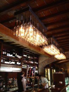 wine bottle chandeliers at the new wine cellar in Italy in Epcot   The picture does not do them justice.  They were amazing.