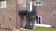 Construction of elegant and unique custom-made wrought iron steel staircases, mono-stringer, floating, modern metal. Shop at Babin Ironworks and purchase your staircase from the masters. Wrought Iron Staircase, Metal Stairs, Garage Attic, Iron Steel, Staircases, Construction, Exterior, Building, Modern