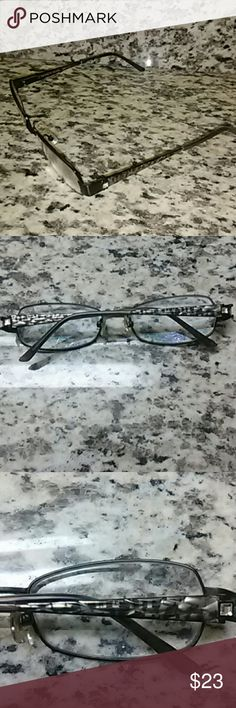 CARMEN MARC VALVO CECILIA EYEGLASS FRAMES These are in great shape with a little wear on the tips that can't be seen when on and can be touched up.  The size is 53 16 130 and it says black next to it.  These are a great exotic cool and you compare to $50 $150 new. Carmen Marc Valvo Accessories Glasses