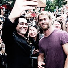 Aww Tom looks so happy and excited he gets to be Loki again and gets to hang out with his brother from another mother Chris and everything about this picture is so perfect and beautiful I can't even