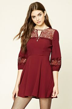 A textured woven skater dress featuring a semi-sheer crochet lace yoke with floral embroidery, a round neckline, front keyhole cutout, long sleeves, and a concealed side zipper.