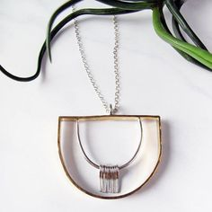We've been posting a lot about our new products because well we love making brand new things. But we love making some of our tried and true products as well. Check out this amazing bench crafted sterling silver and jewellers brass necklace that -E made. I'm surprised we have any for sale because I want to scoop them all up for myself!! Get one for yourself or a gift at our pop-up shop! Have we mentioned that we're having a pop-up shop? #hunterandthistlejewelry  #benchcrafted #jewelry…