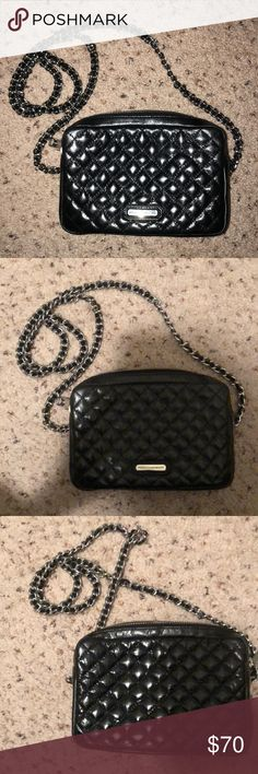 Rebecca Minkoff Black Quilted Silver Chain Purse Rebecca Minkoff Black Quilted Silver Chain Purse I purchased off Poshmark and it is way too small for me. I'm 5'9 and large and it unfortunately just doesn't fit my body. The chain strap can be removed to be used as a clutch. It's super cute but just not practical for me. Rebecca Minkoff Bags Crossbody Bags