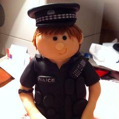Fondant policeman. British police man. New uniform