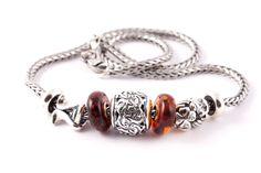 Bracciale da uomo #Trollbeads in argento con #beads Geco e Portafortuna.
