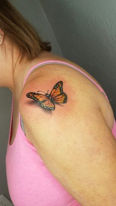 Www.inkinktat.com  Beautiful monarch realistic butterfly tattoo on shoulder tattoo by Chrissy at INK ink Springfield, MO.