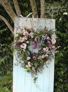 Even though this floral wreaths won't stay vibrant as long as their all-greenery or herbal counterparts, they will be beautiful while they last! @myweddingdotcom