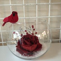 It's a large red velvet rose with some snow, red and white berries, with an added touch of a cardinal. My customers love these! Inexpensive Centerpieces, Floating Candle Centerpieces, Diy Centerpieces, Christmas Centerpieces, Christmas Decorations, Holiday Decor, Winter Wonderland Christmas, Christmas Rose, Christmas Holidays