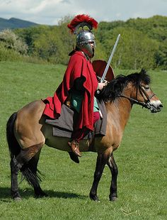An example of a late Roman empire cavalryman, perhaps 5th century CE. His helmet and chainmail already look very much like the armour of later medieval knights. He bears a light, round shield and a lance for stabbing. The sword of the Roman cavalryman was the spatha, a long-bladed weapon, granting the rider a much greater reach than the legionary's short gladius.