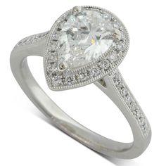 Platinum 1.20ct pear cut diamond halo engagement ring