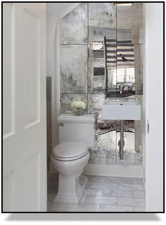 Powder room mirrors - The right decoration makes a small ladies' toilet a desirable area. The powder room, often called a half bath, varies from a standard bathroom as it only has a sink and toilet. Downstairs Bathroom, Bathroom Wall, Wooden Bathroom, Budget Bathroom, Master Bathroom, Bathroom Ideas, Vanity Bathroom, Mirrored Tile Bathroom, Small Wc Ideas Downstairs Loo
