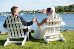 Bride and groom toasting in adirondack chairs, Danversport Yacht Club