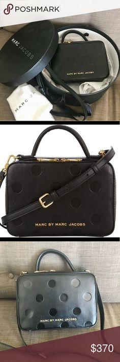 Marc by Marc Jacobs Amaze Dots Party Box Bag A structured Marc by Marc Jacobs handbag brings a playful sensibility to any look. Metallic logo lettering and embossed polka dots add to its sweet charm. A short handle and a removable shoulder strap attach to the top and the lined interior has two pockets. Dust bag and original box are included.  Leather: Lambskin. Weight: 21oz / 0.59kg  MEASUREMENTS Height: 6in / 15cm Length: 8.5in / 21cm Depth: 3.5in / 9cm Strap drop: 22in / 56cm Marc By Marc…