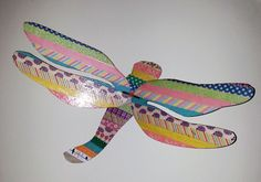 A 3-d dragonfly decorated with Washi Tape.  the dragonfly is from www.craftcuts.com