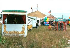 Carson & Barnes Circus.   Trailer on the left is an air operated calliope.