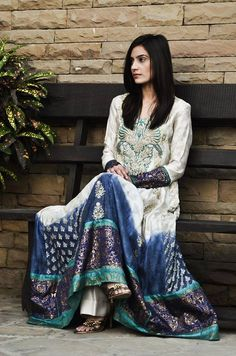 Anarkali white dress with a richly embro. front panel and turquoise & bleeding indigo blue trim by Pak Couture