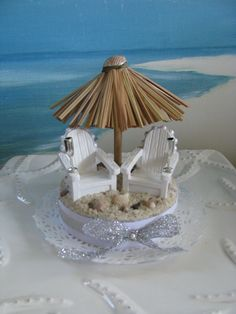 Hey, I found this really awesome Etsy listing at http://www.etsy.com/listing/177404604/tiki-umbrella-wedding-cake-topper
