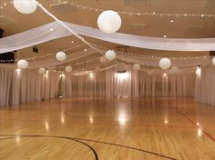 Simple draping of lights and linens incorporating the lanterns too