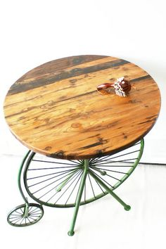 Centre table with cycle wheel bottom and distressed wood finish