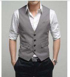 Like the vest with the rolled up shirtsleeves
