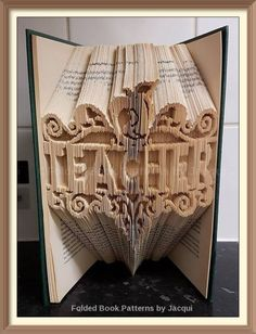 A personal favourite from my Etsy shop https://www.etsy.com/uk/listing/477974596/teacher-framed-book-folding-pattern