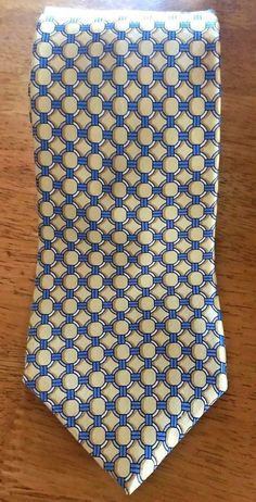 31321795114a Michael Kors 100% Silk Tie - Gold with White Circles & Blue connecting  Bars