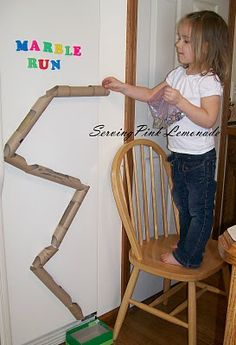 Marble run from paper towel tubes (magnets on the back) on the fridge.