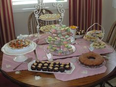 Images of Tea tables laid for a party | Here is the dessert table all laid out.