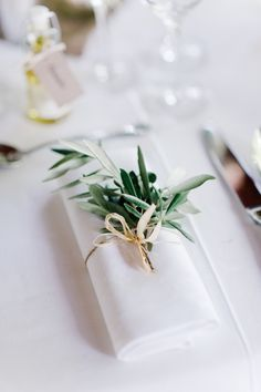 Tie napkins with twine and herbs: http://www.stylemepretty.com/living/2014/11/14/30-ideas-to-dress-up-your-thanksgiving-table/