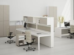 """Estel Spa: Acustic Wall task desk  Comes in compositions of either fishbone rt/lt, angled, crossed , """"T"""",  or """"C"""" shaped  various dimensions and thicknesses with height adjustability varies from 65 to 85 cm"""