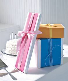 Colorful bands of paper tied with matching ribbon on white wrap