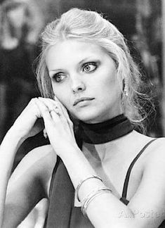 """Pfeiffer's early acting career consisted of modeling and bit parts in films that didn't achieve much critical or box office success: Falling in Love Again (1980) with Susannah York, The Hollywood Knights (1980), and the Curse of the Dragon Queen (1981). Pfeiffer will be the first to tell you she had a long way to go, in fact, what she later said of her early work: """"I needed to learn how to act... in the meantime, I was playing bimbos and cashing in on my looks."""""""