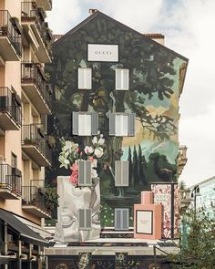 """""""I wanted to paint something very classic and subvert it with a touch of humor. The plaster sculpture is like those given in art class for drawing lessons, upside down so the flowers that are notes in the fragrance are literally coming out of the nose"""" artist @ignasimonreal's inspiration behind the #GucciArtWall in Milan's Largo la Foppa for new fragrance Gucci Bloom #InBloom. #AlessandroMichele"""