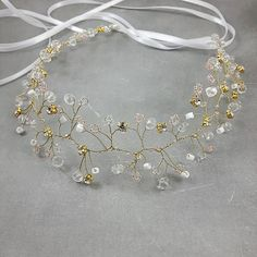 Check out this item in my Etsy shop https://www.etsy.com/listing/474409095/golden-crystal-wedding-headband-bride