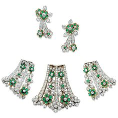 A SET OF EMERALD AND DIAMOND JEWELLERY, BY TIFFANY & CO.   Comprising three brooches, each designed as series of diamond and emerald flowerheads with diamond leaves, within lines of graduated circular-cut diamonds, each with a diamond flowerhead terminal, a pair of ear clips en suite, mounted in gold, 6.0, 4.8 and 4.0 cm  Larger brooch signed Tiffany & Co, earrings no. 13719