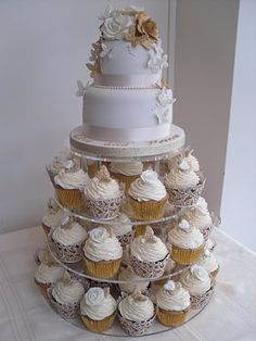 silver, Gold and white 2 tier cake with cupcake tiers