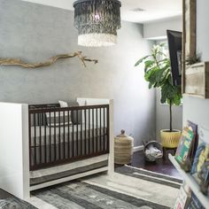 tranquil, sea inspired nursery with soothing colors and gorgeous driftwood  accents